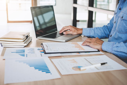 Businessman working analysis finance with calculate about cost on investment, planning data on document, business strategy and accounting concept