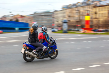 motorcyclist rides at speed on city roads, may 2018, St. Petersburg