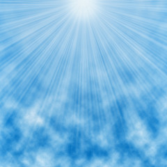 Shiny summer sun lights, white rays rising above blue sky with light clouds background.