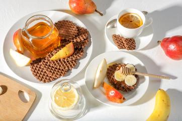 Chocolate waffles with honey and banana.
