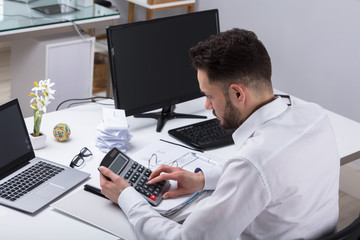 Young Businessman Calculating Bill