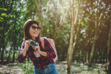 Beauty Asian woman smiling lifestyle portrait of pretty young woman having fun in outdoors summer with digital camera. Traveling of photographer concept. Hipster style and Solo woman theme.