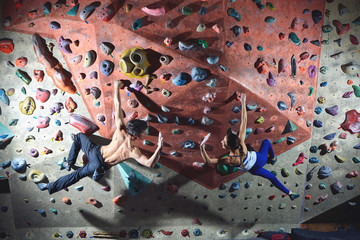 couple climbers climbs indoors
