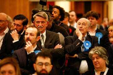 Supporters of the British Conservative Party react during the count at Wandsworth Town Hall after local government elections in London