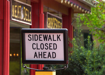 Sidewalk closed sign in front of a deli in Northern California. Rural town.