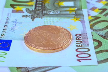 Macro photo - background of the European currency, the Euro, and bitcoin