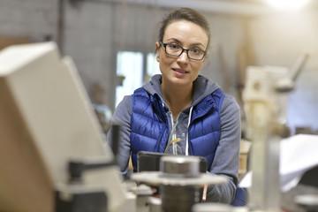 Wood industry technician working on digital tablet
