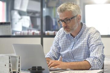 Industrial designer working on laptop computer