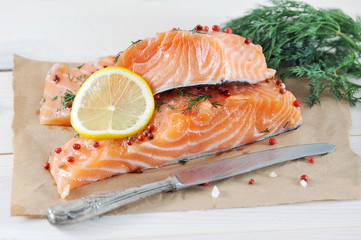 two pieces of salted salmon with lemon and dill