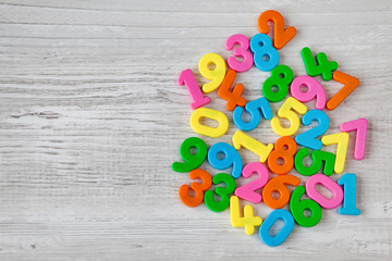 Colorful plastic numbers on a wooden table