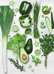 Food Background. Green Vegetables And Fruits On Wooden Table