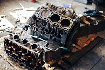 dirty auto engine in garage