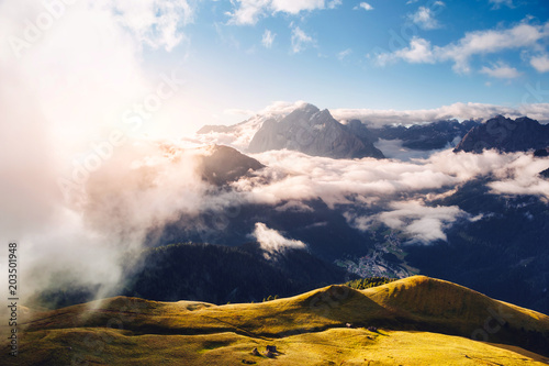 Wall mural Creamy fog covered the glacier Marmolada. Location place Val di Fassa valley, passo Sella, Dolomiti, Italy.