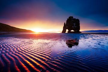 Magic dark sand after the tide. Location place Hvitserkur, Iceland, Europe.
