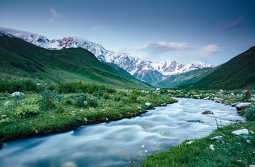 River at the foot of the glacier Shkhara. Location place Svaneti, Mestia, Georgia. High Caucasus ridge.