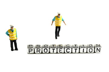 Protection on beads with miniature scale model security guards isolated on a white background
