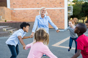 Children and teacher playing together