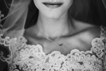 gorgeous sexy lips. bride mouth close up, atmospheric sensual moment. stylish bride  getting ready and posing in the morning. marriage concept. black and white