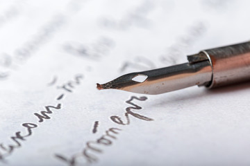 Fountain pen on an antique handwritten letter