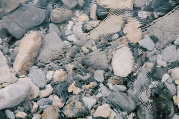 Stones at the bottom of a transparent river