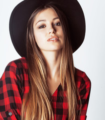 young pretty brunette girl hipster in hat on white background ca