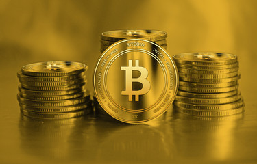 Bitcoin closeup. Cryptocurrency. Golden coins on background. Finance and banking conc