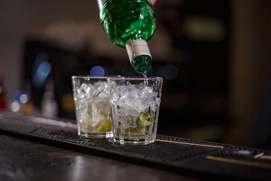 Barman preparing mojito cocktail