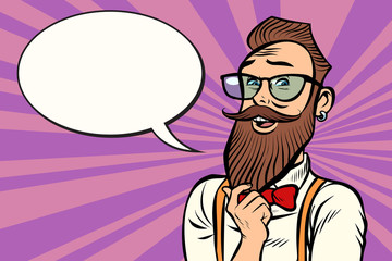 Stylish bearded hipster with glasses thinks