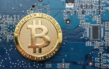 Bitcoin on a Mother board - cryptocurrency concept image