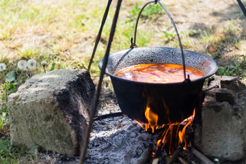 Gulyas stew boiling in a cauldron