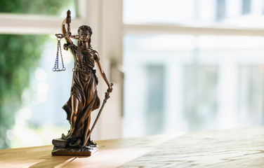 Statue of Justice - lady justice or Iustitia / Justitia the Roman goddess of Justice in a lawyer office, including copy space