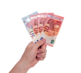 Euro money on white background. The man's hand holds three banknotes of ten euros and one twenty euros in the amount of fifty euros.