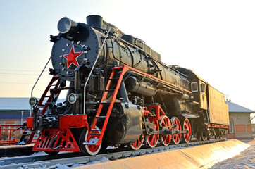Monument to the old steam locomotive. Such steam locomotives were used in the first half of the 20th century, in the Soviet Union