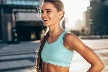 Happy female athlete in morning Wall mural