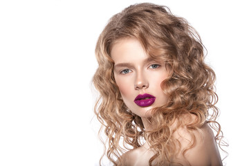 portrait of a beautiful girl with natural make-up. Clean healthy skin, hair and natural lips with bright lipstick. Hairstyle curls. Photographed in studio on a white background.