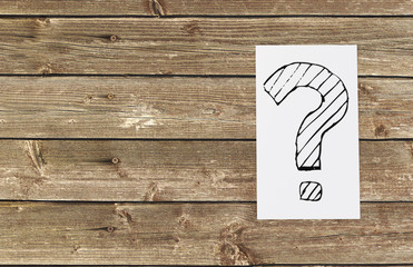 Question mark on paper with wooden background, 3d illustration