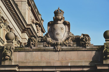 Details of art and decor on Building of The Parliament House of Sweden built in Neoclassical style, with a centered Baroque Revival style facade section in the Gamla stan, old town of Stockholm