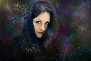 The mystical woman in a black scarf, in space