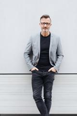 Portrait of mature man wearing grey jacket