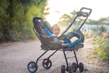 Baby in stroller and sunrise background