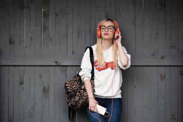girl listening to music, girl enjoying music, relaxing, orange headphones, street shoot, music energy