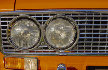 Orange old car headlight with space for text