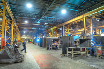 Wide angle view of welding bays in engineering factory