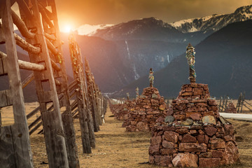 Religious structures, mountains in background, Shangri-La County, Yunnan, China