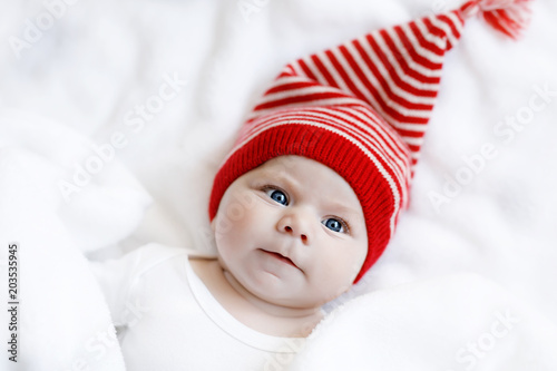 d052ae8cd4d3 Cute adorable baby child with Christmas winter cap on white ...