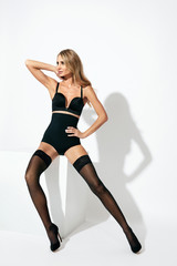 Black Stockings. Young Woman In Lingerie