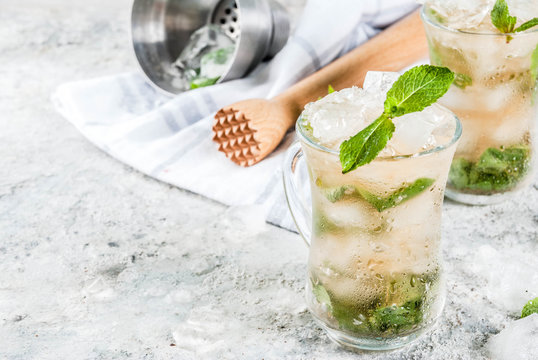 Cold summer beverage, mint julep cocktail drink, grey stone background copy space