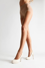 Beige Tights. Long Woman Legs In Stockings