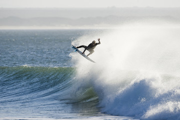 A surfer takes to the air during a free surf