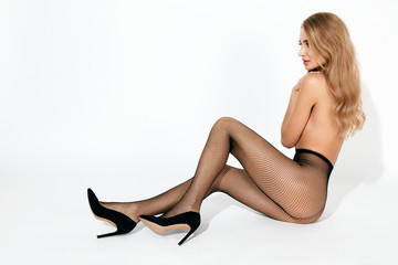 Sexy Woman In Black Fishnet Tights